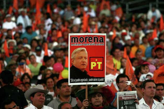 Supporters of mexican presidential candidate of the leftist coalition Progressive Movement of Mexico, Andres Manuel Lopez Obrador, attend a massive event of his electoral campaign, in Tlajomulco, state of Jalisco, on March 31, 2012. Mexico will hold presidential elections next July 1, 2012.   AFP PHOTO/Hector Guerrero Photo: HECTOR GUERRERO, Getty Images / 2012 AFP