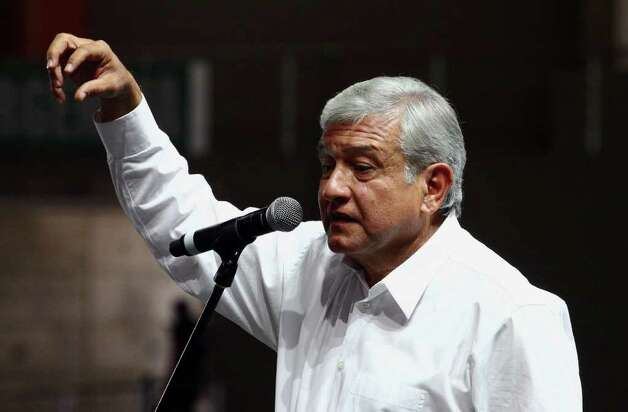 Mexican presidential candidate of the leftist coalition Progressive Movement of Mexico, Andres Manuel Lopez Obrador, addresses supporters during a massive event of his electoral campaign, in Tlajomulco, state of Jalisco, on March 31, 2012. Mexico will hold presidential elections next July 1, 2012. AFP PHOTO/Hector Guerrero Photo: HECTOR GUERRERO, Getty Images / 2012 AFP