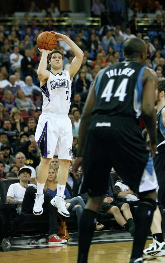 Sacramento Kings guard Jimmer Fredette, left, shoots over Minnesota Timberwolves defenders during the second half of an NBA basketball game in Sacramento, Calif., Monday, April 2, 2012. The Kings won 116-108.(AP Photo/Steve Yeater) Photo: Steve Yeater