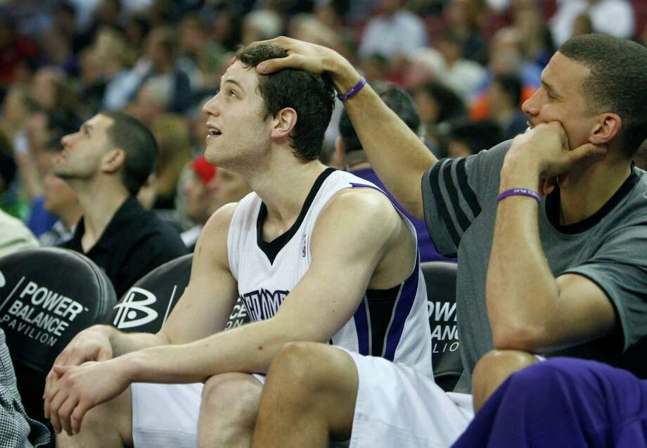 Sacramento Kings guard Jimmer Fredette, left, gets a pat on the head from teammate Francisco Garcia during the second half of an NBA basketball game in Sacramento, Calif., Monday, April 2, 2012. (AP Photo/Steve Yeater/archive) Photo: Steve Yeater