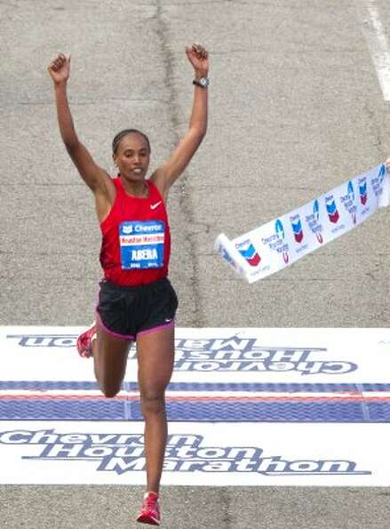 Alemitu Abera crosses the finish line to win the women's Chevron Houston Marathon. Abera ran an an u
