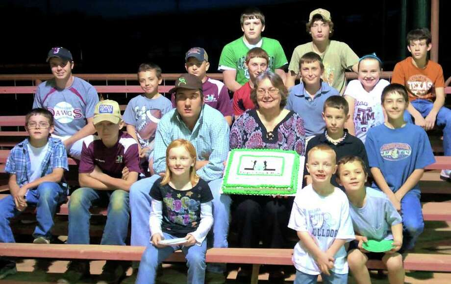 Dru Miller, center with cake, was honored for her volunteer efforts to Jasper 4-H groups. Photo: Courtesy Photo
