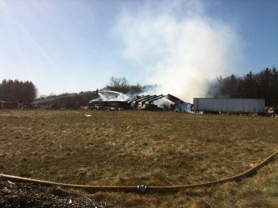 The building of a business that manufactures firestarting bricks in Schodack N.Y., caught fire Tuesday morning April 3, 2012. Firefighters from 15 departments work to put the blaze out. (Paul Buckowski / Times Union) Photo: (Paul Buckowski / Times Union)