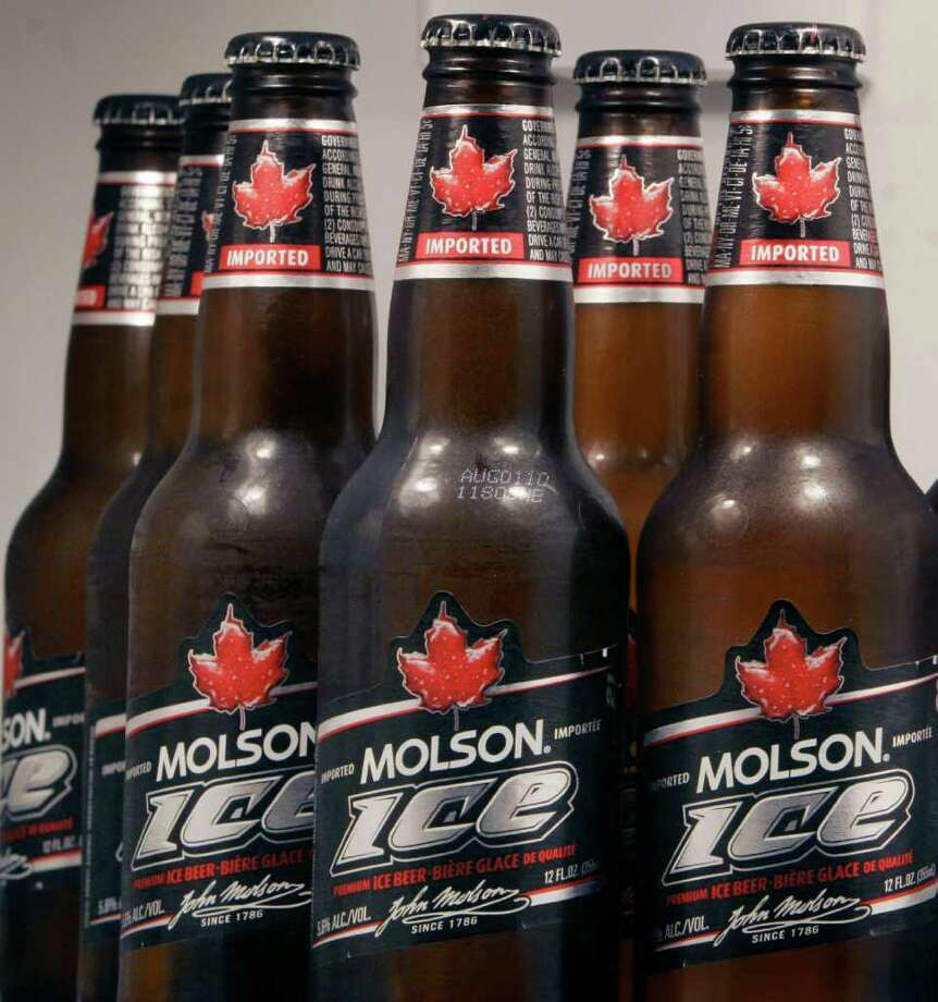 FILE -  A May 3, 2010 file photo shows a display of Molson Ice beer sits arranged in a refrigerator in Marborough, Mass.  Molson Coors is spending $3.54 billion to buy the StarBev and its nine breweries in central and eastern Europe as it expands its operations.   (AP Photo/Bill Sikes, file) Photo: Bill Sikes / AP2010