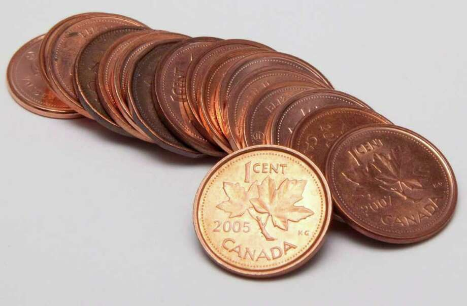 Canadian pennies are shown in Vancouver, in a 2010 file photo. Photo: AP