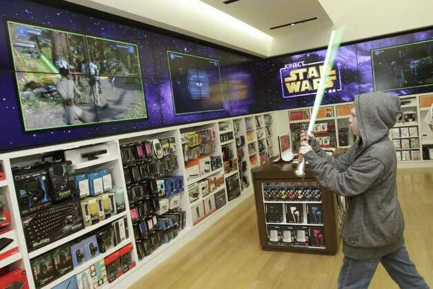 Nathan Purnell, 11, pretends he's a Jedi as he plays the new Kinect Star Wars game at the Star Wars Midnight launch at the Microsoft Store at Bellevue Square in Bellevue, Washington, April 2, 2012. Photo: Robert Sorbo/Microsoft/Handout