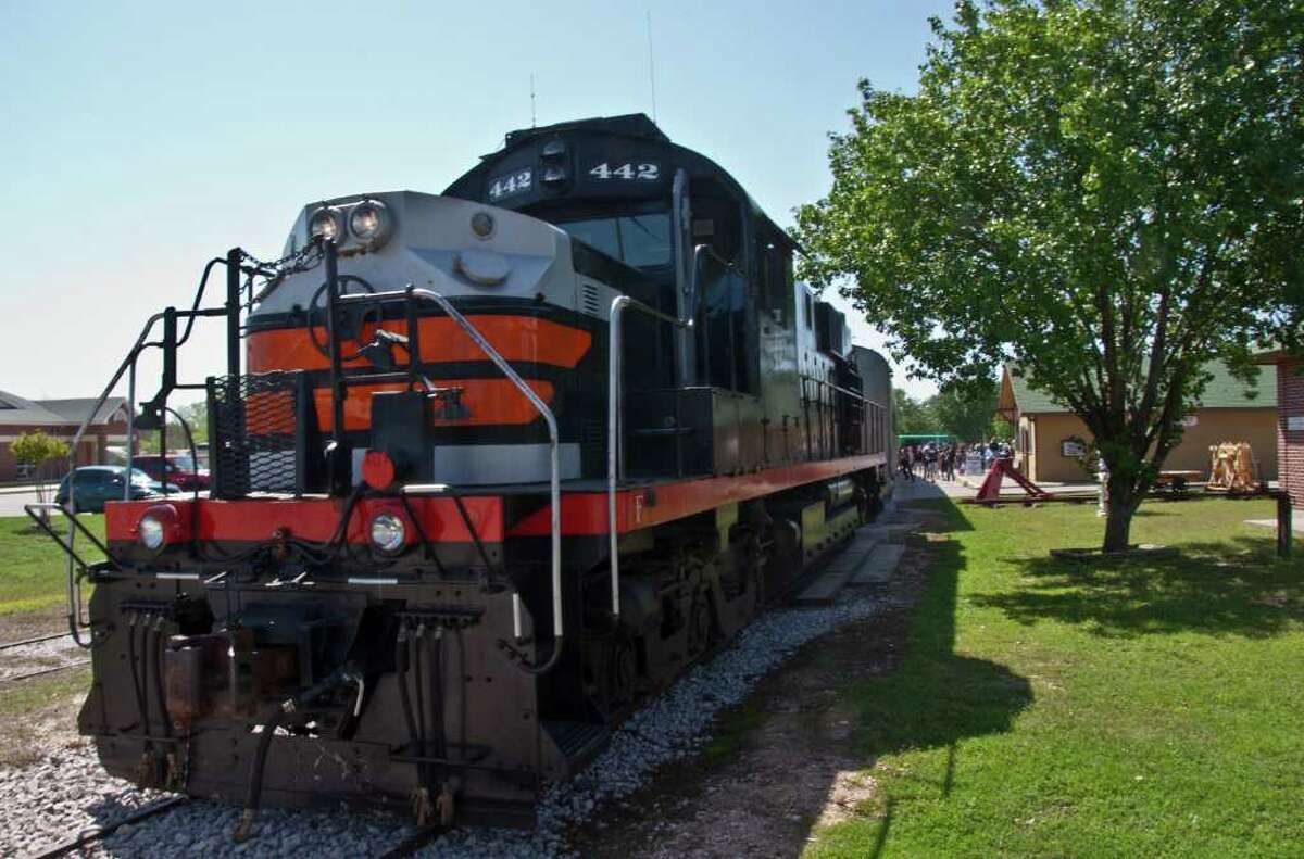 Parked at the Burnet train station, the 442 diesel engine waits for people to board before heading back to Cedar Park.