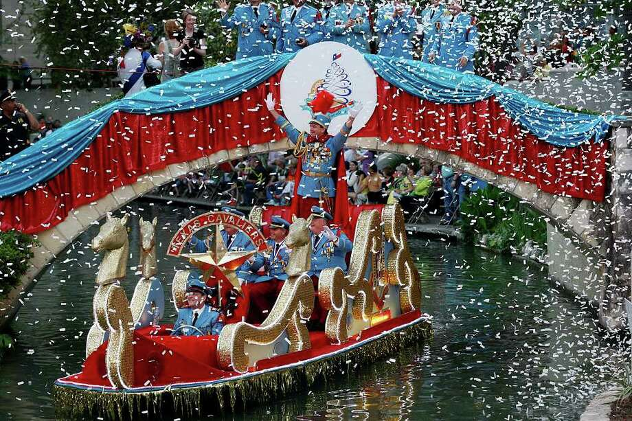 King Antonio LXXXIX Bill Mitchell and his aides float in last year's Texas Cavaliers River Parade. Several local TV personalities have signed on as hosts this year. Photo: Express-News File Photo / SAN ANTONIO EXPRESS-NEWS