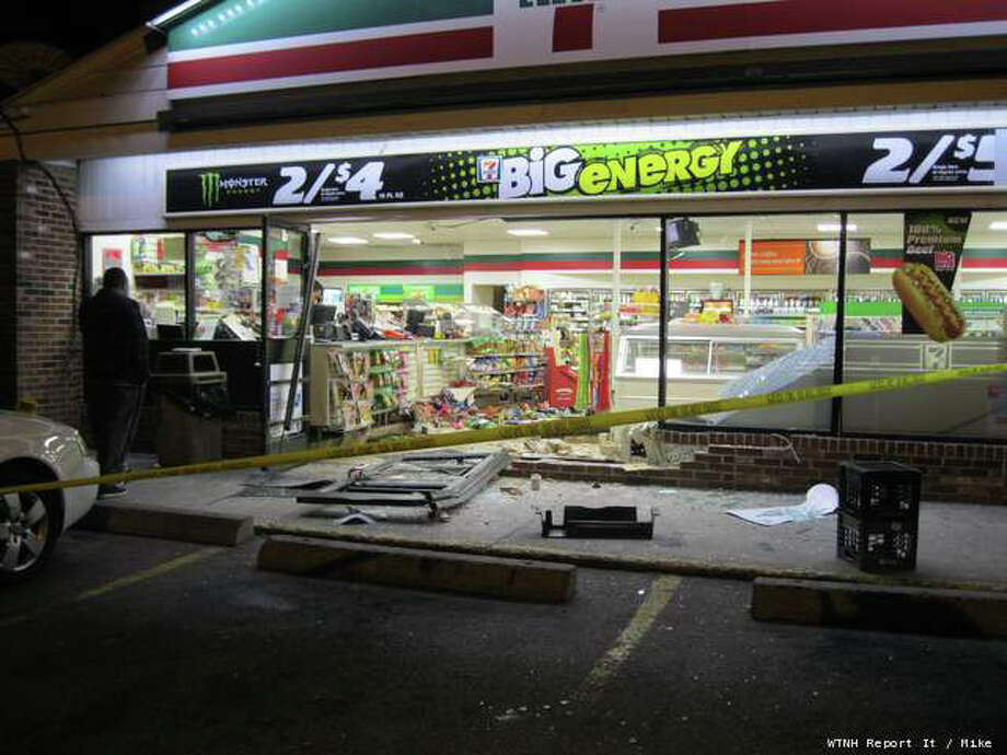 They were picking up the pieces Tuesday morning, April 3, 2012 at a 7-Eleven in Waterbury after someone drove their car right through the front door. It happened around 9:35 p.m. Monday night a 511 Cooke Street. Photo: WTNH