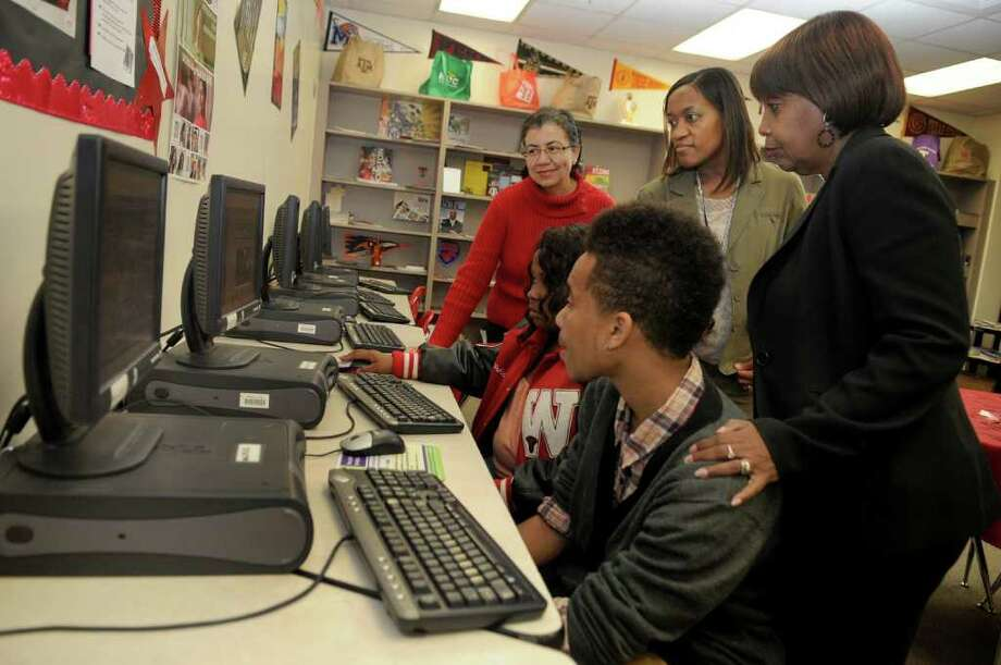Silvia Cuellar, top from left, a member of the Barbara Jordan Endeavors Corp. Advisory Board, Jonchea Walker, Westfield High School College Connections Counselor; and Thelma Scott, BJEC Founder; help Westfield High School Barbara Jordan Ambassadors Chris Turner, 17, a junior, and Tonishia Derousseaux, 19, a senior, during a computer session in the WHS College Connections office. Photo: Jerry Baker