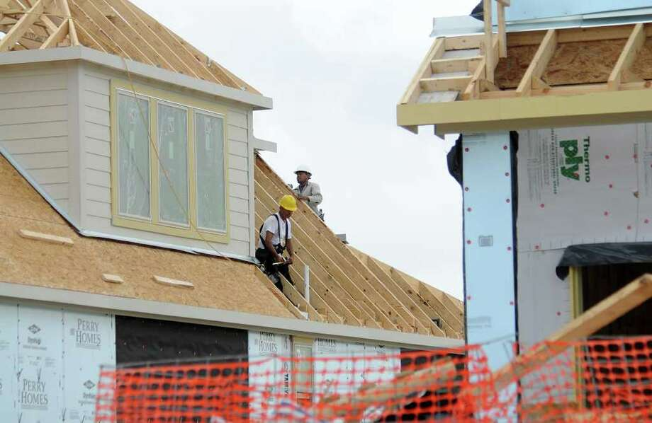 Workers frame a house under construction in Bridgeland. Some residents are concerned about plans for proposed apartments. Photo: David Hopper / freelance