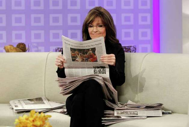 "Sarah Palin holds a newspaper as she co-hosts NBC News' ""Today"" show in New York on Tuesday, April 3, 2012. Palin was the much-hyped guest co-host on NBC's ""Today,"" going head-to-head against former ""Today"" anchor Katie Couric, who this week is subbing on ""Good Morning America"" at her current workplace, ABC. Photo: AP"