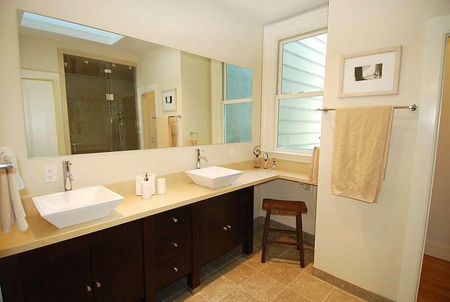 A contemporary bathroom boasts dual sinks. Photo: Derrick Doo