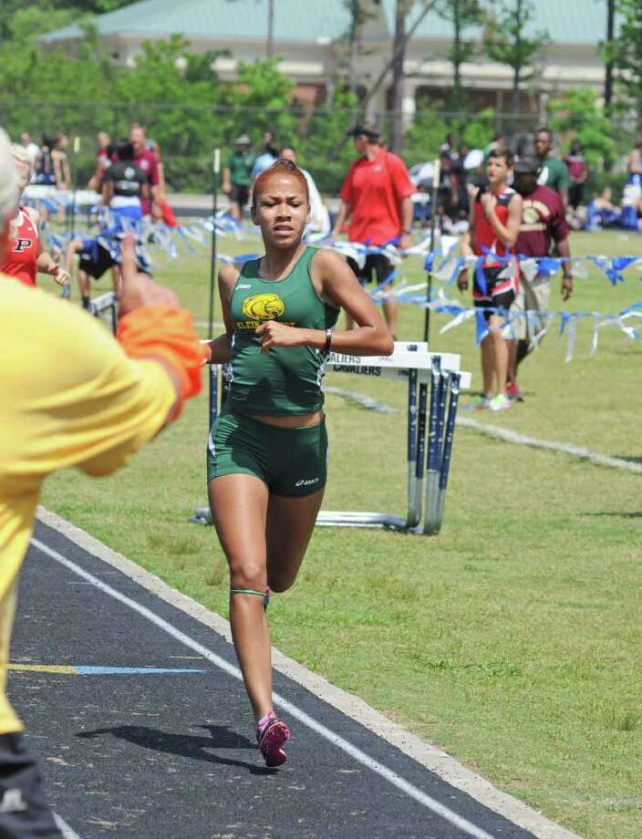 Klein Forest sophomore Selena Peters, left, is a medal favorite in the 800 meters, while Klein Oak junior Eugene Estes is among the top contenders in the long jump at the District 13-5A meet next week at Klein ISD Memorial Stadium. Photo: L. Scott Hainline / For The Chronicle