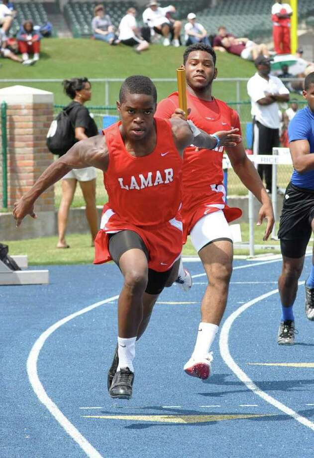 Lamar track and field Daniel Lopez hands off to Davin Williams in the 4 X 100 meter  PHOTO BY KATHIE MAXWELL / DirectToArchive