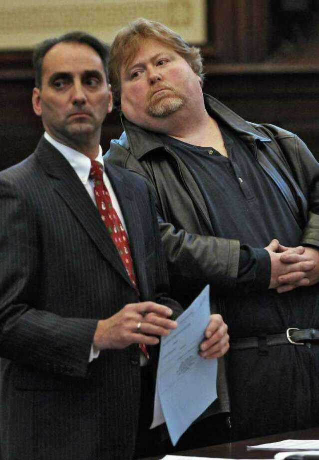 Anthony DeFiglio, right,  pled guilty to falsifying business records for his role in a ballot fraud case in Rensselaer County Court on Tuesday Dec. 20, 2011 in Troy, N.Y. His lawyer John Turi is at left. (Philip Kamrass / Times Union ) Photo: Philip Kamrass / 00015833A