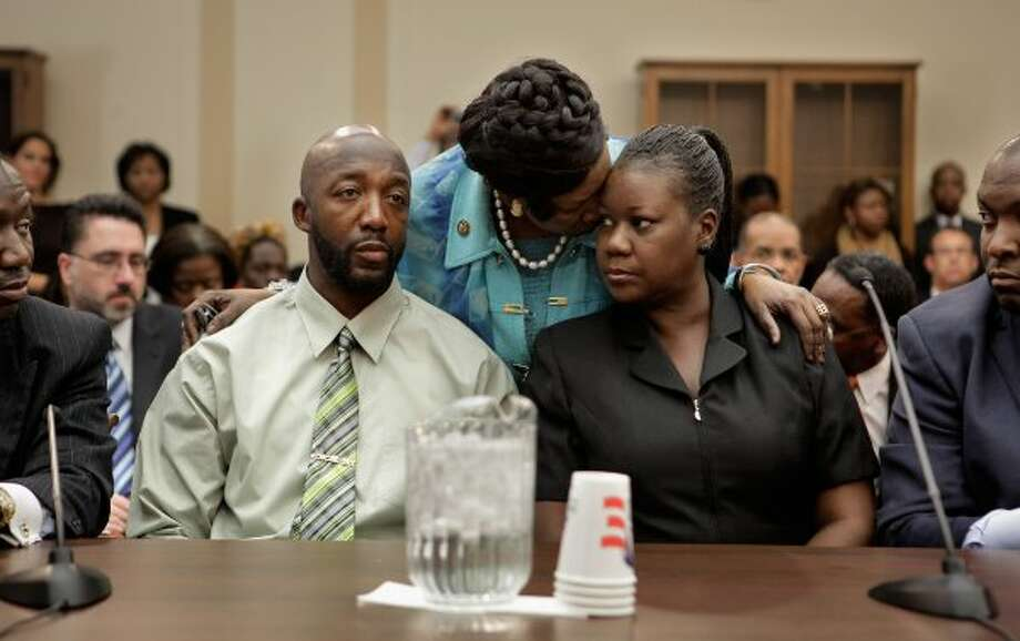 Rep. Sheila Jackson-Lee embraces Sybrina Fulton and Tracy Martin, the parents of Trayvon Martin, during a House Judiciary Committee briefing on March 27, 2012. (Chip Somodevilla / Getty Images)