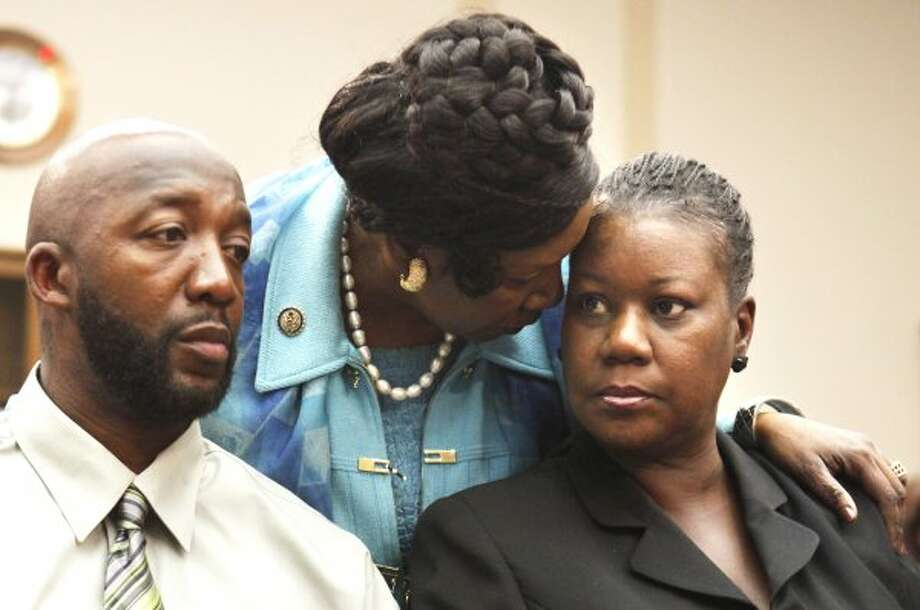 Rep. Sheila Jackson Lee greets Trayvon Martin's parents, Tracy Martin and Sybrina Fulton, during a House Judiciary Committee briefing on racial profiling and hate crimes on March 27, 2012. (Jacquelyn Martin / The Associated Press)