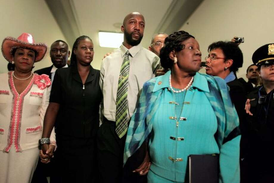 The parents of Trayvon Martin, Tracy Martin and Sybrina Fulton, are escorted by Rep. Frederica Wilson, D-Fla., attorney Benjamin Crump, Rep. Bobby Rush, R-Ill. and Rep. Sheila Jackson-Lee after attending a House Judiciary Committee hearing in Washington, D.C. (Chip Somodevilla / Getty Images)