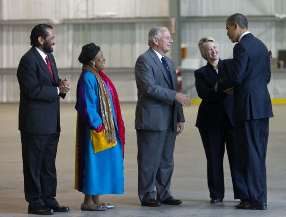 President Barack Obama is welcomed by Houston Mayor Anisse Parker, Congressman Gene Green, Congresswoman Shelia Jackson Lee and Congressman Al Green on March 9, 2012, in Houston. (Bob Levey / The Associated Press)