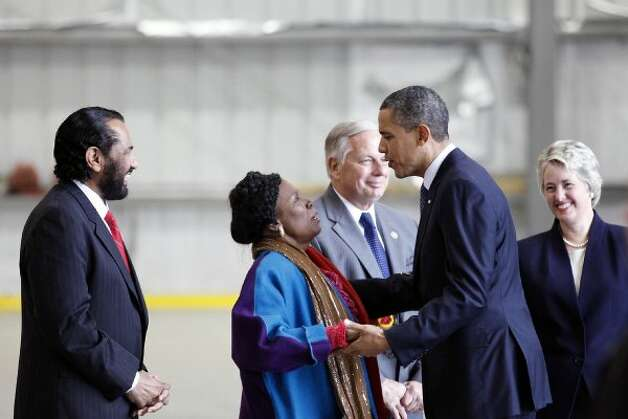 President Barack Obama greets Sheila Jackson Lee, shortly after arriving on Air Force One on March 9, 2012, at Ellington Airport in Houston. (Todd Spoth / For The Chronicle)