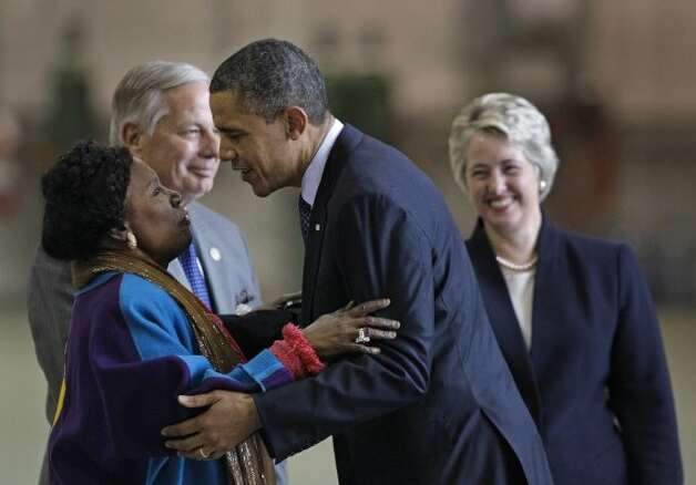 Congresswoman Shelia Jackson Lee hugs President Barack Obama as she greets him at Ellington Field on March 9, 2012, in Houston. (Melissa Phillip / Houston Chronicle)