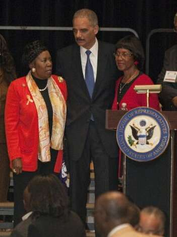 Congresswoman Sheila Jackson Lee, U. S. Attorney General Eric Holder and Rose Mary McGowan, the sister of Barbara Jordan, visit at Wheatley High School in Houston on Feb. 13, 2012. (Melissa Phillip / Houston Chronicle)