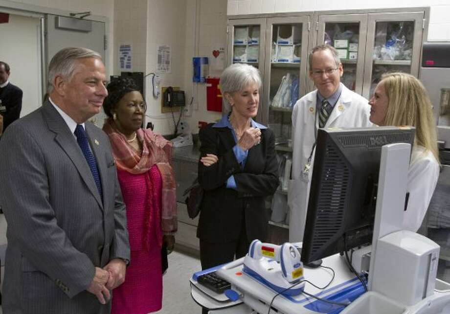 Ben Taub, Dr. John Riggs, Dr. Angela Fisher, Congressman Gene Green and  Congresswoman Sheila Jackson Lee listen to a question from Kathleen Sebelius, Health and Human Services secretary, during a tour of Ben Taub General Hospital in Houston. (Thomas B. Shea / For the Chronicle)