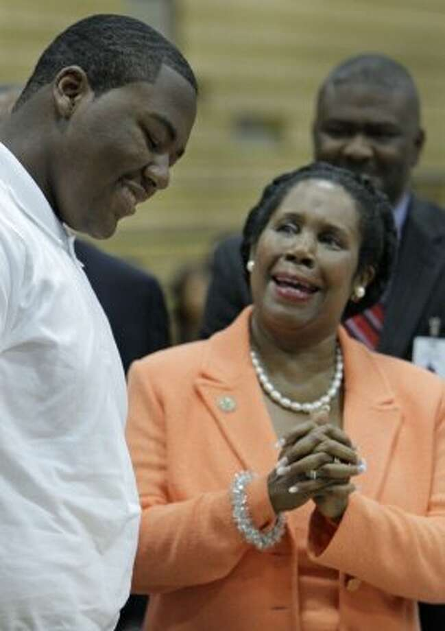 Carl Lewis, 17, a sophomore, reacts shyly when asked by Congresswoman Sheila Jackson Lee to speak to the media during his first day of school at North Forest High School in Houston on Aug. 22, 2011. (Melissa Phillip / Houston Chronicle)