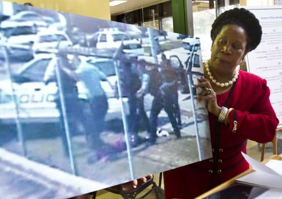 Sheila Jackson Lee shows a vid capture of the Chad Holley video as she talks about her efforts to have the authorities made accountable by the public on Feb. 14, 2011, in Houston. (Nick de la Torre / Houston Chronicle)