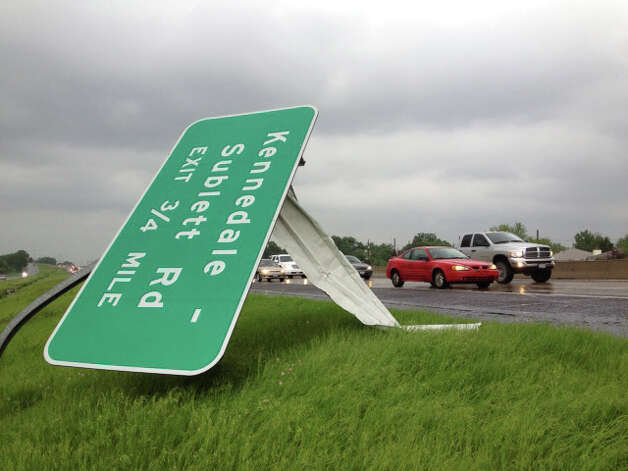 "A sign is destroyed from a passing  storm in Arlington, Texas on US Route 287 on Tuesday. Several reported tornadoes tore through the Dallas area on Tuesday, tossing semis in the air and leaving crumpled tractor trailers strewn along highways and in truck stop parking lots.   The National Weather Service reported at least two separate ""large and extremely dangerous"" tornadoes south of Dallas and Fort Worth. Photo: AP"