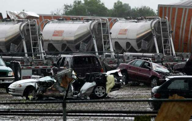 Destroyed vehicles sit in a Kenworth trailer lot after a tornado that swept through the area toppling many of the trailers on the lot Tuesdayin Lancaster, Texas. Tornadoes tore through the Dallas area Tuesday, peeling roofs off homes, tossing big-rig trucks into the air and leaving flattened tractor trailers strewn along highways and parking lots. Photo: AP