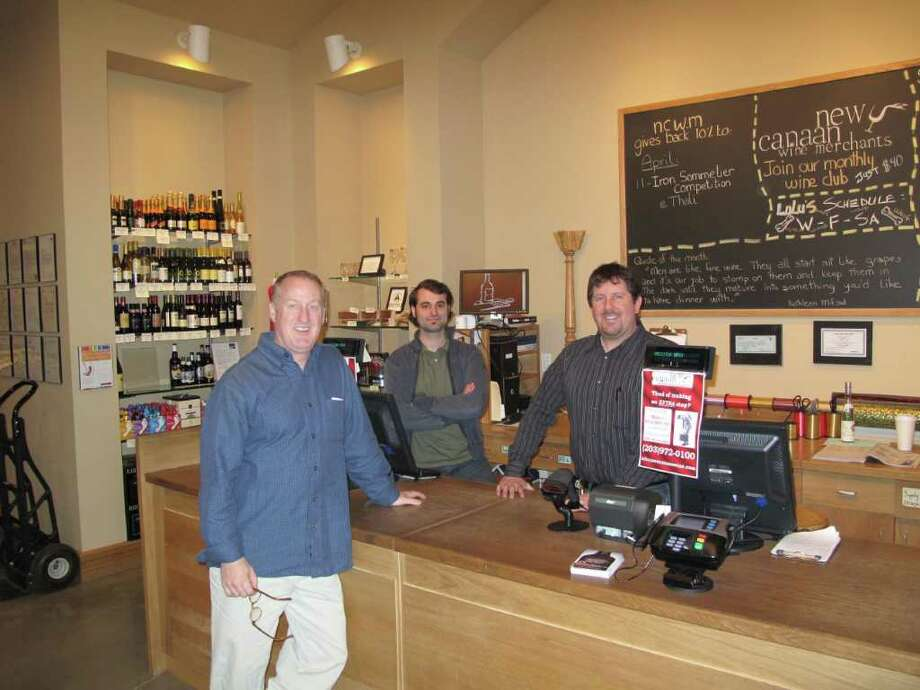 Left to Right: Owner Jeff Barbour, employee Matthew Vitti and general manager Jeffery Lesnick are proud of New Canaan Wine Merchant's success. Photo: Paresh Jha
