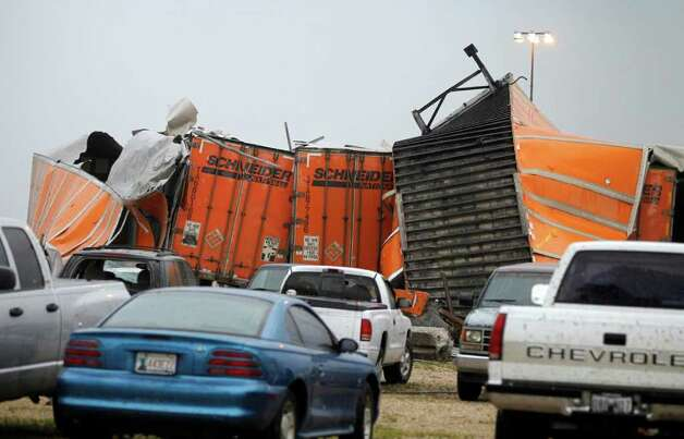 "Trailers lay smashed atop one another after a tornado reportedly tore through the southeastern portion of Dallas County, Texas, Tuesdaynear Lancaster. The National Weather Service confirmed at least two separate ""large and extremely dangerous"" tornadoes in the Dallas-Fort Worth area. Several other developing twisters were reported as a band of violent storms moved north through the metropolitan area. Officials had no immediate information about injuries. Photo: AP"