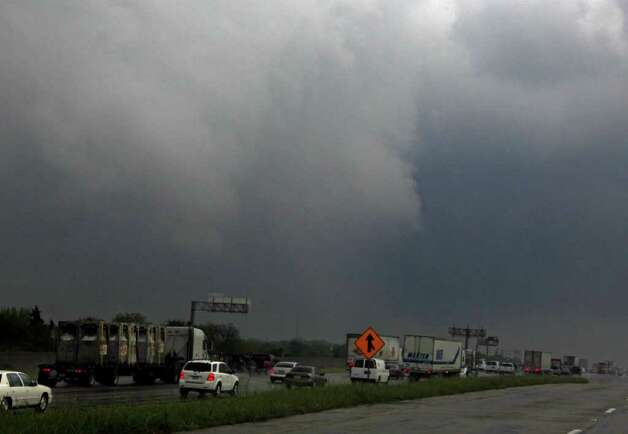 "Cloud rotation moves over Interstate 20 after a tornado reportedly tore through the southeastern portion of Dallas County on Tuesday near Lancaster, Texas The National Weather Service confirmed at least two separate ""large and extremely dangerous"" tornadoes in the Dallas-Fort Worth area. Several other developing twisters were reported as a band of violent storms moved north through the metropolitan area. Officials had no immediate information about injuries. Photo: AP"