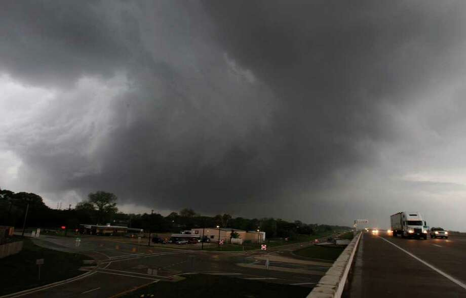 Storm clouds head towards Dallas-Fort Worth Airport from Highway 161 looking north from Grand Prairie, Texas, on Tuesday, April 3, 2012. (AP Photo/The Dallas Morning News, Louis DeLuca) Photo: Louis DeLuca, Associated Press / Louis DeLuca/The Dallas Morning News