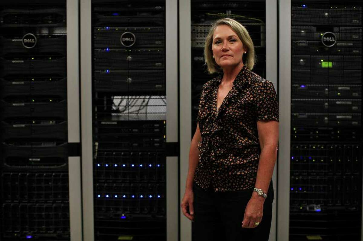 biz- Lisa McComb, President/COO of elumicor, stands with Dell servers that serve as a repository for millions of pages of legal documents for AT&T and other clients at the elumicor office in San Antonio on Thursday, June 2, 2011. LISA KRANTZ/lkrantz@express-news.net