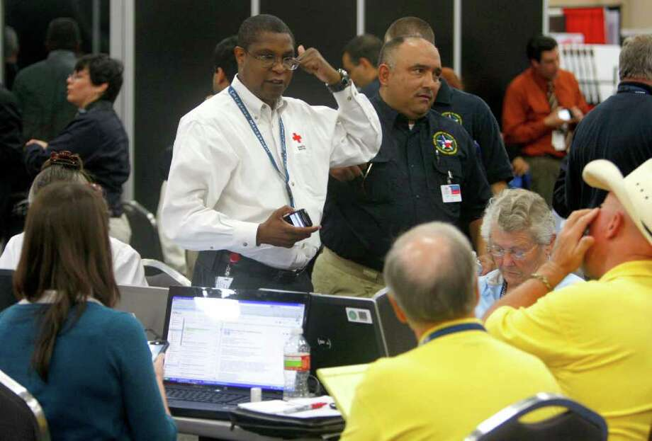 Officials work to create a temporary emergency operation center Tuesday, April 3, 2012, at the Convention Center to respond to a string of tornadoes and wide spread damage in the Dallas-Fort Worth area. Photo: William Luther, San Antonio Express-News / © 2012 WILLIAM LUTHER