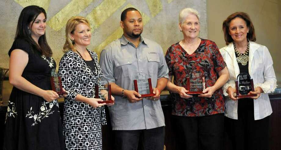 High levels of performance and initiative, in addition to a positive attitude in a diverse environment, won special recognition for five Lamar University employees during an annual staff reception and program Tuesday. Distinguished Staff Awards, from left, were earned by Katrina Brent of Port Neches, College of Engineering director of marketing who's been with the school since 2006; Tammy Hebert of Nederland, executive assistant to the College of Fine Arts and Communication dean, on staff since 2004; Thruston Byerly of Beaumont, Lamar Mail Center postal assistant, on staff since 1994; Rebecca Caddy of Village Mills, College of Engineering senior academic advisor who has been at Lamar since 1996; and Mary Gagne of Beaumont, Texas Academy of Leadership in the Humanities director since 1998.  Dave Ryan/The Enterprise Photo: Dave Ryan
