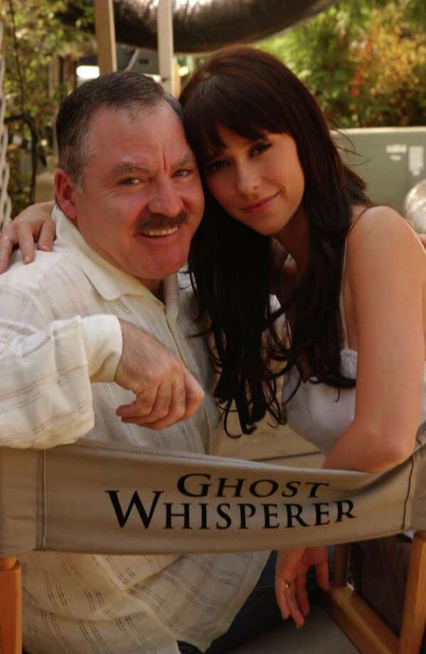"James Van Praagh, the original ìGhost Whisperer,î is shown here with actress Jennifer Love Hewitt, of the ""Ghost Whisperer"" television series. Van Praagh will be at the Ridgefield Playhouse Thursday, April 5, for a 7:30 p.m. show.  Photo: MICHAEL YARISH / CBS ©2005 CBS BROADCASTING INC.  All Rights Reserved. PROD. #106 Photo: Contributed Photo"
