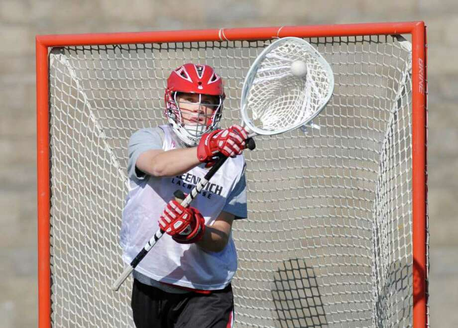 Greenwich High School lacrosse goalie Ryan Fisher makes a stop during boys lacrosse practice at Greenwich High School, Tuesday afternoon April 3, 2012. Photo: Bob Luckey / Greenwich Time