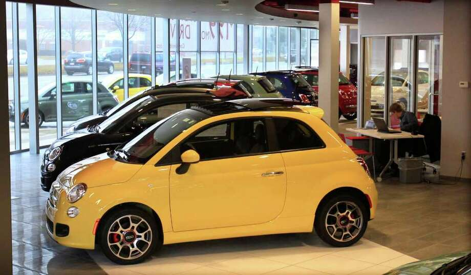 In a Feb. 29, 2012 photo, Fiat 500 vehicles are displayed at the Golling Fiat dealership in Birmingham, Mich. Chrysler Group was the first automaker to report sales Tuesday, April 3, 2012. Its U.S. sales jumped 34 percent in March on strong sales of Fiat small cars and Chrysler sedans.    (AP Photo/Carlos Osorio) Photo: Carlos Osorio