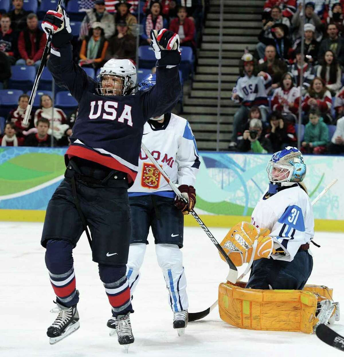 VANCOUVER, BC - FEBRUARY 18: Julie Chu of The United States celebrates scoring their first goal during the ice hockey women's preliminary game between USA and Finland on day 7 of the 2010 Vancouver Winter Olympics at UBC Thunderbird Arena on February 18, 2010 in Vancouver, Canada. (Photo by Harry How/Getty Images)
