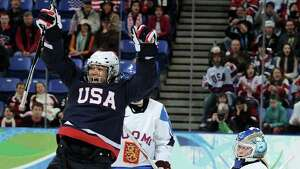 Fairfield's Julie Chu has been named to the U.S Olympic team for a fourth time. She will represented the United States during the Winter Games in Sochi, Russia, which begin in February. (Photo by Harry How/Getty Images)