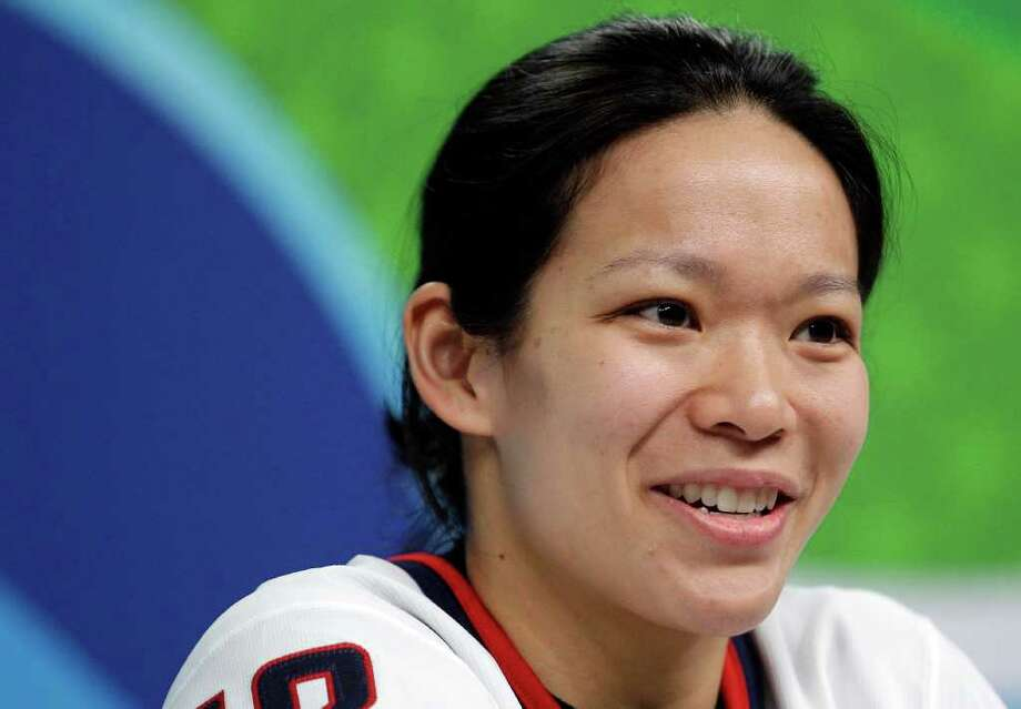 Julie Chu of the USA women's ice hockey team answers questions during a press conference in Vancouver, British Columbia, Thursday, Feb. 11, 2010. (AP Photo/Gerry Broome) Photo: Gerry Broome, AP / AP
