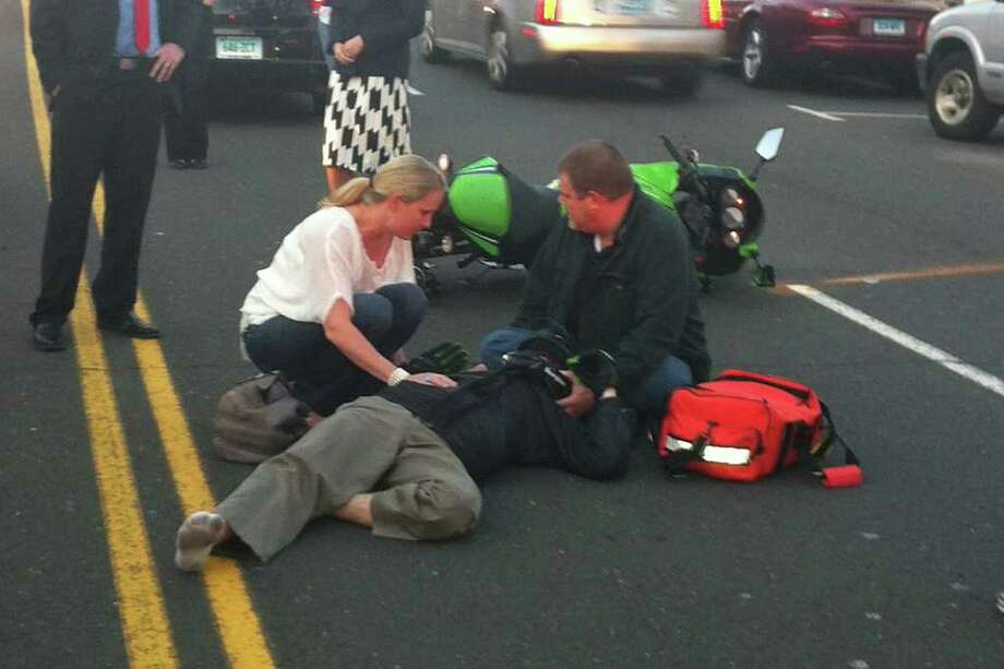 A motorcyclist was injured during a collision with an SUV on West Putnam Avenue Tuesday, April 3, 2012. Photo: Contributed Photo