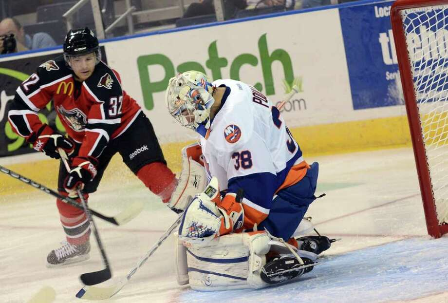 Bridgeport Sound Tigers' goalie Kevin Poulin defends against Portland Pirates' Ryan Duncan during the AHL season opener at the Webster Bank Arena in Bridgeport on Saturday, Oct. 8, 2011. Photo: Amy Mortensen / Connecticut Post Freelance