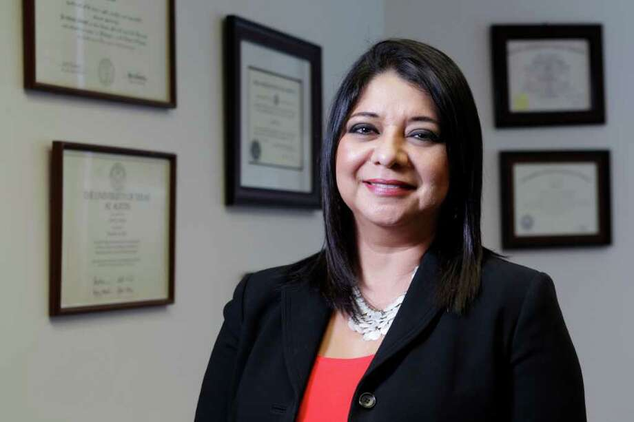 Houston immigration attorney Linda Vega runs a program called Latinos Ready to Vote. She conducts citizenship forums in conjunction with Houston Mayor Annise Parker's office. Photo: Melissa Phillip, Houston Chronicle / © 2012 Houston Chronicle
