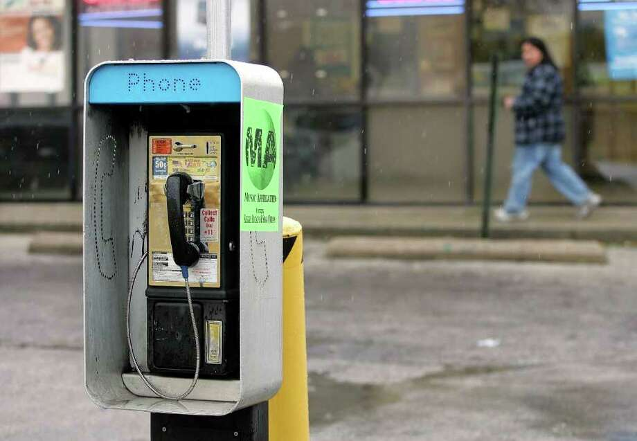 "About 500,000 pay phones still existed  in 2009,   down from 2.1  million in 1999, according to a 2010 Federal  Communications Commission ""Trends in Telephone Service"" report. Photo: Getty Images"