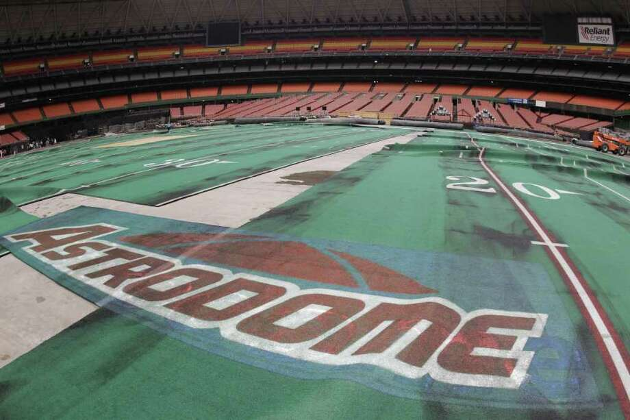 Damaged Astro Turf is seen stretched across the floor inside of Reliant Astrodome Tuesday, April 3, 2012, in Houston. Photo: Melissa Phillip, Houston Chronicle / © 2012 Houston Chronicle